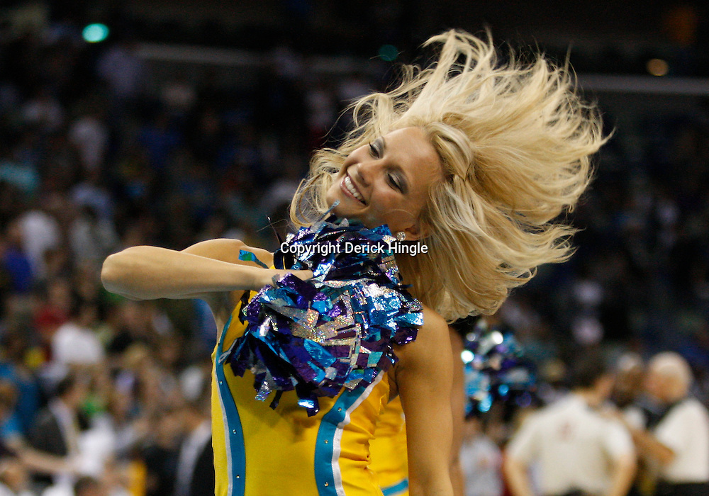 Mar 31, 2010; New Orleans, LA, USA; A New Orleans Hornets Honeybees dancer performs during the second half against the Washington Wizards at the New Orleans Arena. The Wizards defeated the Hornets 96-91. Mandatory Credit: Derick E. Hingle-US PRESSWIRE