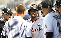 May 31, 2017 - Miami, FL, USA - The Miami Marlins greet second baseman Dee Gordon after he scored the team's first run via an RBI single by center fielder Christian Yelich in the first inning against the Philadelphia Phillies on Wednesday, May 31, 2017 at Marlins Park in Little Havana in Miami, Fla. (Credit Image: © Pedro Portal/TNS via ZUMA Wire)