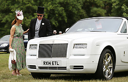 Racegoers stand by a Rolls Royce car during day two of Royal Ascot at Ascot Racecourse.