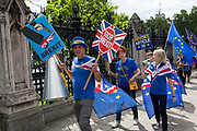 Following the attack by far-right Tommy Robinson supporters on Remain protesters the previous week, pro-EU campaigners led by Steve Bray walk through Parliament Square  during a regular protest in Parliament Square, on 15th July 2019, in London, England. A crowdfunded plea to replace destroyed Remain flags and poles resulted in over £50,000 being raised.