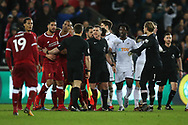 Tempers flare at the end of the match as referee Neil Swarbrick © calms everyone down.Premier league match, Swansea city v Liverpool at the Liberty Stadium in Swansea, South Wales on Monday 22nd January 2018. <br /> pic by  Andrew Orchard, Andrew Orchard sports photography.