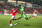 Forest Green Rovers Manny Monthe(3) crosses the ball during the Vanarama National League match between Wrexham FC and Forest Green Rovers at the Racecourse Ground, Wrexham, United Kingdom on 26 November 2016. Photo by Shane Healey.