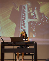 Ashley Holland performs The Little Pianist - Minuet by Bach; Fur Elise by Beethoven during Holy Trinity's talent show Tuesday afternoon.  (Karen Bobotas/for the Laconia Daily Sun)