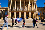 """28 NOVEMBER 2020 - DES MOINES, IOWA: People walk around the Iowa State Capitol during the """"Stop the Steal"""" rally Saturday. About 30 supporters of US President Donald Trump gathered at the Iowa State Capitol to rally in support of the President and in opposition to the outcome of the US election. They are a part of the """"Stop the Steal"""" movement which has spread across the US. This is the fourth week that there have been """"Stop the Steal"""" rallies at state capitols across the US. Most independent observers and election officials, both Republican and Democratic, have said the election was free and fair and that there was no election of fraud.           PHOTO BY JACK KURTZ"""