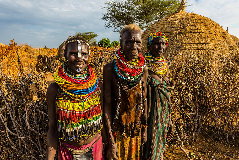 Nyangatom tribe women wearing layers of beaded necklaces as decoration. They also wear pieces of watch strap as ornamentation. Omo Valley, Ethiopia.
