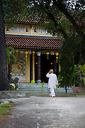 A nun walks to the Chua Dieu Vien Pagoda before prayer begins, Hue, Vietnam.  Photo by Stan Olszewski/SOSKIphoto