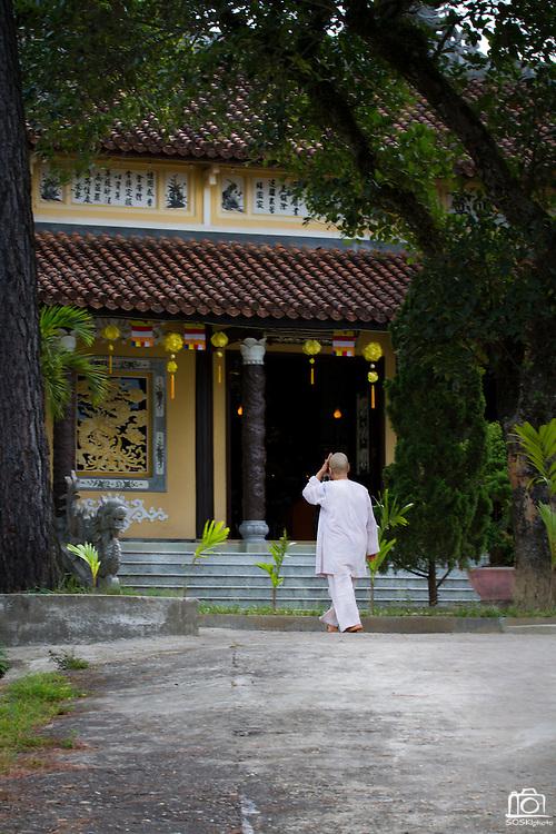 A nun walks to the Chua Dieu Vien Pagoda before prayer begins, Hue, Vietnam.  Photo by Stan Olszewski/SOSKIphoto
