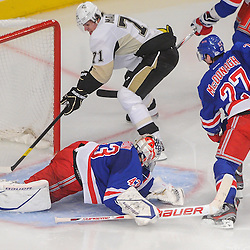 Pittsburgh Penguins center Evgeni Malkin (71) scores on New York Rangers goalie Martin Biron (43) during second period NHL action between the Pittsburgh Penguins and the New York Rangers at Madison Square Garden in New York, N.Y.