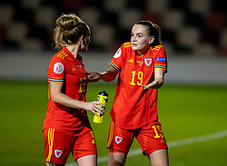 NEWPORT, WALES - Thursday, October 22, 2020: Wales' goal-scorer Lily Woodham (R) with team-mate Rachel Rowe (L) after the UEFA Women's Euro 2022 England Qualifying Round Group C match between Wales Women and Faroe Islands Women at Rodney Parade. Wales won 4-0. (Pic by David Rawcliffe/Propaganda)