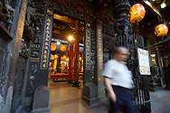 A man exits the famous Miaokou Temple in Keelung, Taiwan.  Taiwanese people are fairly religious and mostly follow the Daoism and Buddhism.