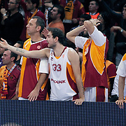 Galatasaray's Joshua Ian Shipp (L), Ender Arslan (C) and Caner Topaloglu (R) during their Euroleague group D matchday 6 Galatasaray between Asseco Prokom at the Abdi Ipekci Arena in Istanbul at Turkey on Thursday, November 24 2011. Photo by TURKPIX