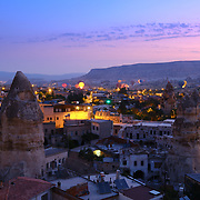 Panorama of Goreme village at sunrise with hot air balloons, Cappadocia