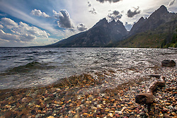 """The Grand Tetons from North Jenny Lake on a windy afternoon. The cathedral group is the prominent formation here consisting of the Grand Teton, Mt. Teewinot, and Mt. Owen.  Mt St. John is on the right.<br /> <br /> For production prints or stock photos click the Purchase Print/License Photo Button in upper Right; for Fine Art """"Custom Prints"""" contact Daryl - 208-709-3250 or dh@greater-yellowstone.com"""