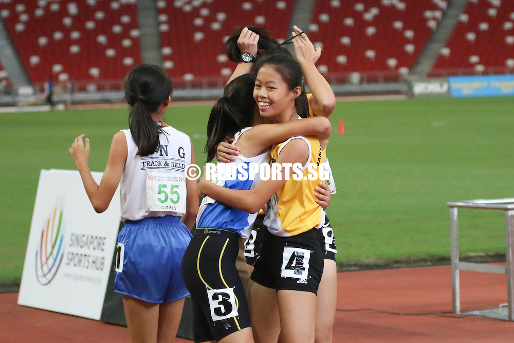 Bernice Liew (#407) and Elizabeth-Ann Tan (#414, left) of Nanyang Girls' sharing a moment after finishing their race. (Photo © Chua Kai Yun/Red Sports)