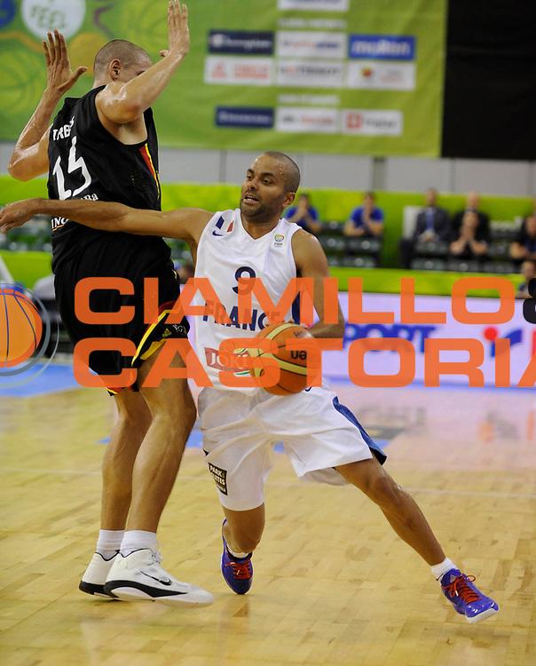 DESCRIZIONE : Lubiana Ljubliana Slovenia Eurobasket Men 2013 Preliminary Round Francia Germania France Germany<br /> GIOCATORE : Tony Parker<br /> CATEGORIA : palleggio dribble<br /> SQUADRA : Francia France<br /> EVENTO : Eurobasket Men 2013<br /> GARA : Francia Germania France Germany<br /> DATA : 04/09/2013 <br /> SPORT : Pallacanestro <br /> AUTORE : Agenzia Ciamillo-Castoria/Herve Bellenger<br /> Galleria : Eurobasket Men 2013<br /> Fotonotizia : Lubiana Ljubliana Slovenia Eurobasket Men 2013 Preliminary Round Francia Germania France Germany<br /> Predefinita :