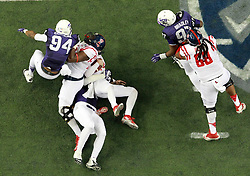 Dec 31, 2014; Atlanta , GA, USA; Mississippi Rebels offensive lineman Laremy Tunsil (78) has his leg injured as TCU Horned Frogs defensive end James McFarland (40) falls on his leg after tacking Mississippi Rebels quarterback Bo Wallace (14) during the second quarter in the 2014 Peach Bowl at the Georgia Dome. Mandatory Credit: Kevin Liles/CFA Peach Bowl via USA TODAY Sports