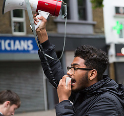 London, July 24th 2017. Protesters from Stand Up To Racism demonstrate outside Stoke Newington police station and then march to the shop where Rashan Charles died after being chased and apprehended by police, who say that he tried to swallow an object after running in to a shop following a police stop on the car he was traveling in.