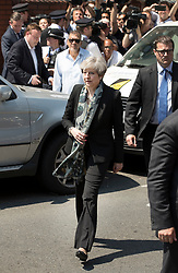 © Licensed to London News Pictures. 19/06/2017. London, UK. Prime Minister Theresa May leaves Finsbury Park Mosque. Finsbury Park in north London where earlier a van ploughed into a crowd near Finsbury Park Mosque, as they finished taraweeh, Ramadan evening prayers. One person has been killed and 10 people are injured. Photo credit: Peter Macdiarmid/LNP