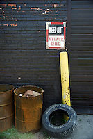 """USA, Chicago, August 25, 2009.   A forbidding sign warns casual passers-by to keep out of Meyer Steel Drum, part of LVEJO's 'toxic tour."""" The Little Village Environmental Justice Organization, headquartered in a predominantly Mexican-American neighborhood of Chicago, campaigns not only against pollution but for clean power, park facilities, urban agriculture, and restoring public transit. LVEJO's staff and volunteers make significant outreach and education efforts, especially for youth. Photo for an HOY feature story by Jay Dunn."""