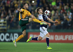 Lithuania's Arturas Zulpa (left) and Scotland's Stuart Armstrong battle for the ball during the 2018 FIFA World Cup Qualifying, Group F match at the LFF Stadium, Vilnius.