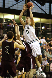 16 December 2006: Zach Freeman leans over a pair of defenders to shoot from the middle of the lane. The University of Chicago Maroons upset  the Illinois Wesleyan Titans 64 - 60 at the Shirk Center in Bloomington Illinois.<br />