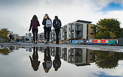 Edinburgh, Scotland, UK. 5 October, 2020. After a weekend of heavy rain from Storm Alex , members of the public were out on the towpath of the Union Canal at Fountainbridge today enjoying some dry, calm weather. Pictured; Students from Boroughmuir High School on their lunch break.  Iain Masterton/Alamy Live News