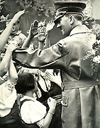 Adolf Hitler greets crowd during a visit to a German town, c1938.