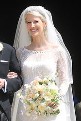 Newlywed Lady Gabriella Windsor smiles on the steps of the chapel with their bridesmaids, page boys and guests after their wedding at St George's Chapel in Windsor Castle.