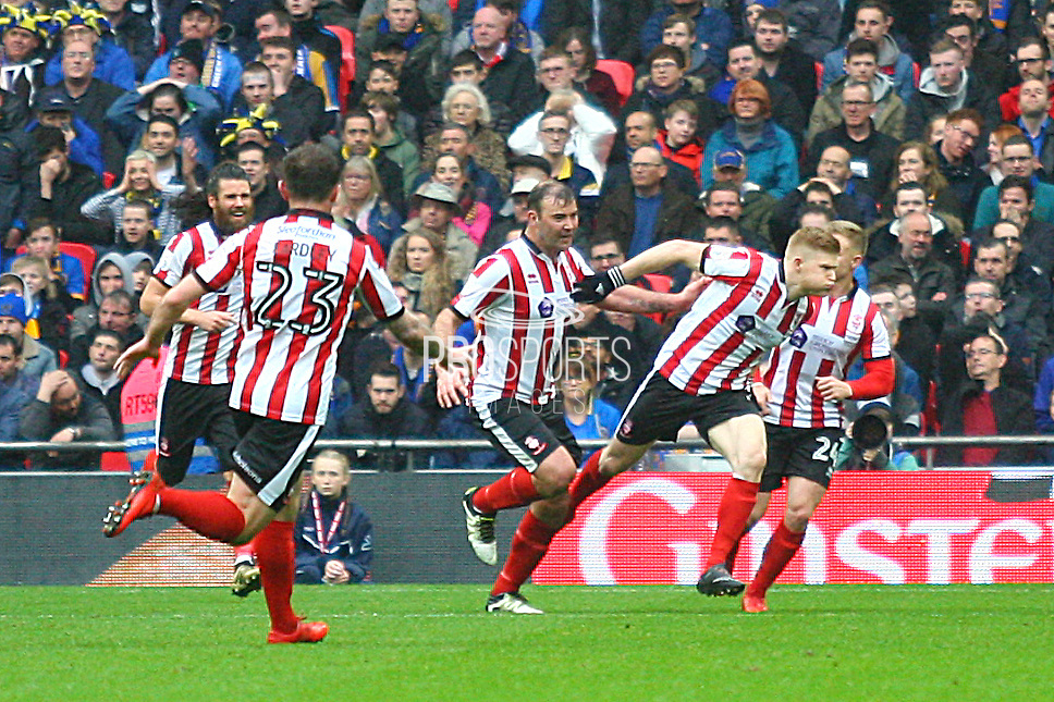 Lincoln City's Elliott Whitehouse scores a goal and celebrates 1-0 during the EFL Trophy Final match between Lincoln City and Shrewsbury Town at Wembley Stadium, London, England on 8 April 2018. Picture by John Potts.