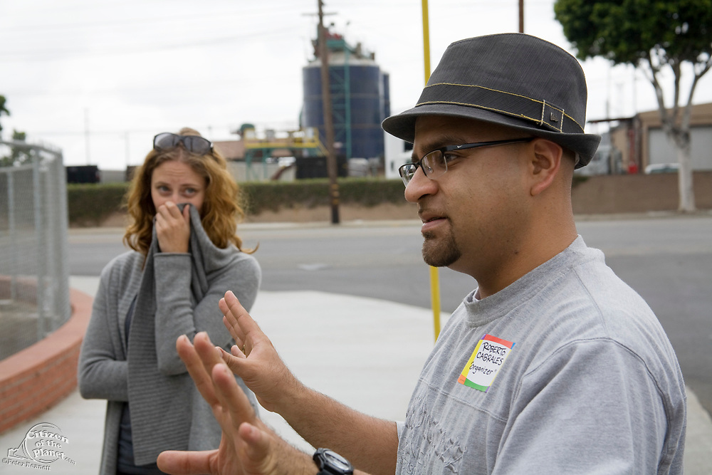 Roberto Cabrales talks about the toxicity and smell from the the lead rendering plant in the background. CBE (Communities for a Better Environement) Toxic Tour takes attendees through various toxic sites in and around Los Angeles, vernon, Los Angeles, California, USA