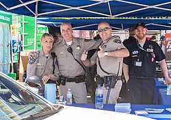 June 22, 2018 - Sonoma, CA, U.S. - SONOMA, CA - JUNE 22:  Officers from the California Highway Patrol working a booth on Friday, June 22, 2018 at the Toyota/Save Mart 350 Practice day at Sonoma Raceway, Sonoma, CA (Photo by Douglas Stringer/Icon Sportswire) (Credit Image: © Douglas Stringer/Icon SMI via ZUMA Press)