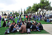 Israel, Haifa University, Students sit on the lawn during a break in studies