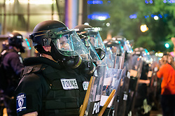 September 21, 2016 - Charlotte, North Carolina, U.S. - Police officers stands their ground during a protest and eventual riot in Uptown Charlotte. This is the second day of violence that erupted after a police officer's fatal shooting of Keith Scott Tuesday afternoon. (Credit Image: © Sean Meyers via ZUMA Wire)