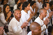 """04 FEBRUARY 2013 - PHNOM PENH, CAMBODIA:  Cambodians pray during a cremation chanting service for King-Father Norodom Sihanouk at Wat Ounalom (also spelled Wat Onalaom) in Phnom Penh. Norodom Sihanouk (31 October 1922- 15 October 2012) was the King of Cambodia from 1941 to 1955 and again from 1993 to 2004. He was the effective ruler of Cambodia from 1953 to 1970. After his second abdication in 2004, he was given the honorific of """"The King-Father of Cambodia."""" Sihanouk died in Beijing, China, where he was receiving medical care, on Oct. 15, 2012.   PHOTO BY JACK KURTZ"""