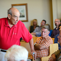 072314  Adron Gardner/Independent<br /> <br /> Lidio Renaldi Sr. comments to Rehoboth McKinley Christian Healthcare board member Brett Newberry at a McKinley County Commission meeting at the McKinley County Courthouse in Gallup Thursday.