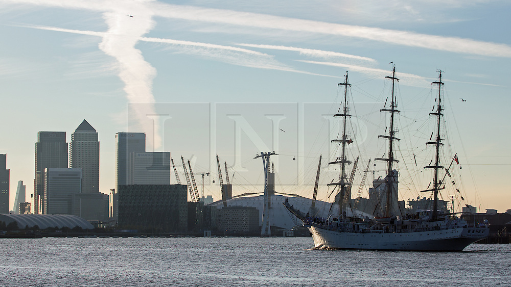 © Licensed to London News Pictures. 03/09/2014. The huge tall ship Dar Mlodziezy arrived in London the evening of September 3rd in readiness for this weekend's Royal Greenwich Tall Ships Festival. Reckoned to be the largest tall ship on the Thames for 25 years, the 108-metre-long Class A ship arrived in London shortly before sunset. She will be joined by approximately 50 other ships for the regatta this weekend which is expected to draw over a million people. All of the ships will leave in a Parade of Sail on September 9th. It is the biggest Tall Ships event on the Thames since the Tall Ships Race of 1989. Credit : Rob Powell/LNP