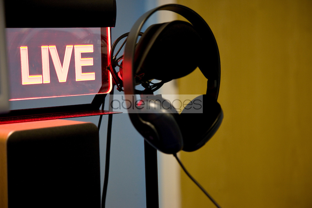 Microphone and headphones with an illuminated sign