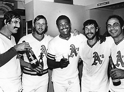 End of a era, Oct 1976, A's players, Rollie Fingers,Joe Rudi, Don Baylor, Gene Tenace, and Sal Bando celebrate with champagne all leaving Charlie Finley. (Campy Campaneris) not in photo also was leaving..(copyright 1976 Ron Riesterer)