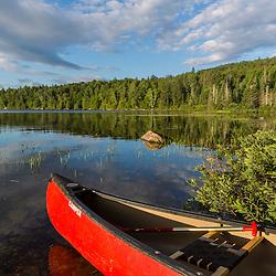 A canoe on the shore of Bald Mountain Pond. Bald Mountain Township, Maine.