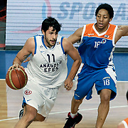 Anadolu Efes's Cenk Akyol (L) and Mersin BSB's Anthony Grundy (R) during their Turkish Basketball League match Anadolu Efes between Mersin BSB at Sinan Erdem Arena in Istanbul, Turkey, Saturday, January 14, 2012. Photo by TURKPIX