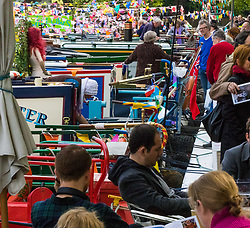 Little Venice, London, April 30th 2017. Narrowboaters from all over the uK gather for the annual Canalway Cavalcade, held on the May Day Bank holiday weekend, organised by the Inland Waterways Association, where boaters get the chance to display their immaculately prepared and brightly painted craft as well as compete in various manoeuvring tests. PICTURED: Members of the public admire the colourful display of narrowboats.<br /> Credit: ©Paul Davey<br /> To licence contact: <br /> Mobile: +44 (0) 7966 016 296<br /> Email: paul@pauldaveycreative.co.uk<br /> Twitter: @pauldaveycreate