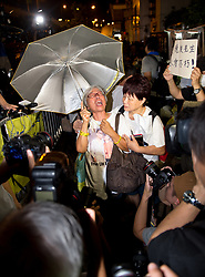 July 14, 2017 - Hong Kong, Hong Kong SAR, China - HKSAR 20th Anniversary Basic Law seminar. Wan Chai.© Jayne RussellProtester Alexandra Wong screams and cries. Following the death in China of Lui Xiaobo, the Nobel peace laureate, people protest outside the Liaison Office of the Central People's Government in the Hong Kong Special Administrative Region. (Credit Image: © Jayne Russell via ZUMA Wire)