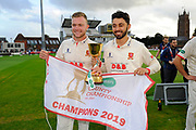 Sam Cook of Essex and Aron Nijjar of Essex  pose with the County Championship trophy during the Specsavers County Champ Div 1 match between Somerset County Cricket Club and Essex County Cricket Club at the Cooper Associates County Ground, Taunton, United Kingdom on 26 September 2019.