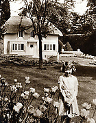 Princess Elizabeth (Elizabeth II of Great Britain from 1952) as a child in the garden of Royal Lodge, Windsor with Y Bwthyn Bach (The Little House) the play house given by the people of Wales
