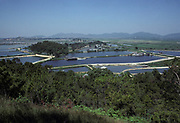 A 1970s landscape of duck farms and rural paths at Lok Ma Chau in the New Territories of northern Hong Kong, a village within the territory's Frontier Closed Area, a buffer zone established by the Hong Kong government to prevent illegal immigrants from mainland China, and access to the area is restricted to those holding Closed Area Permits, on 16th April 1979, in Hong Kong, China.