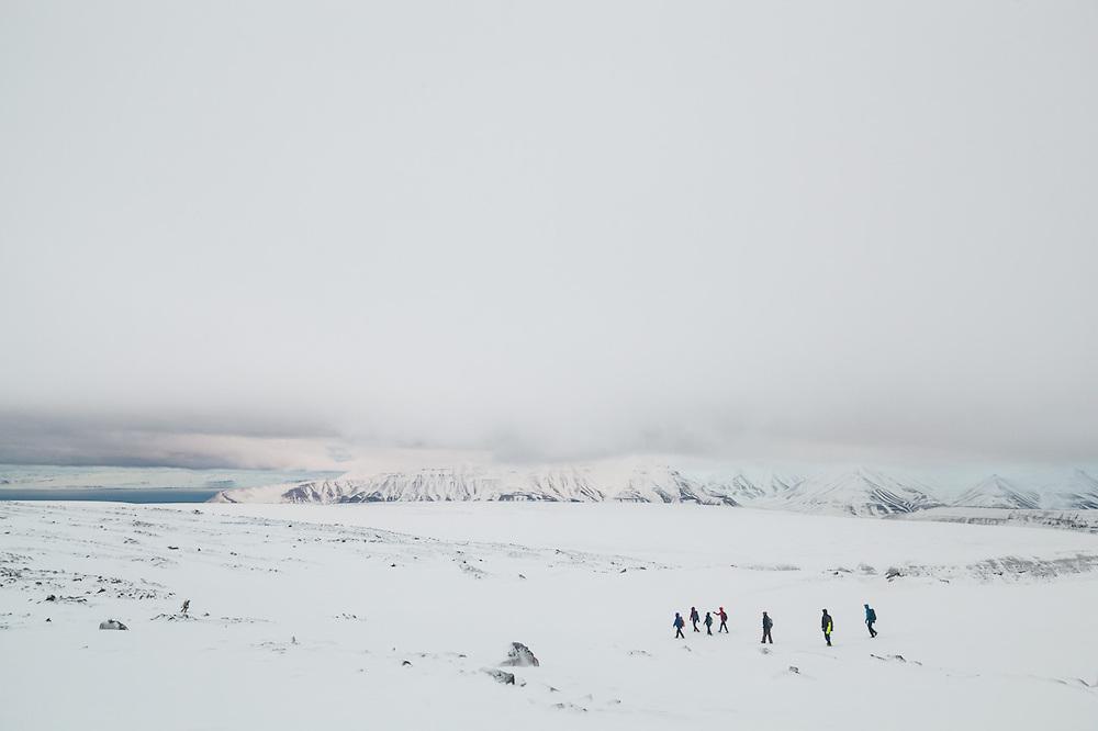 UNIS students from nearby Longyearbyen hike down from Nordenskioldfjellet, Svalbard.