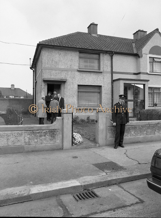 """John O'Grady Rescued By Gardai.   (R67)..1987..05.11.1987..11.05.1987..5th November 1987..After being kidnapped from his home in Cabinteely, Co Dublin, John O'Grady was finally rescued after twenty one days in captivity. he was located in a house inCarnlough Road, Cabra West, Dublin. During his ordeal Mr O""""Grady was mutilated by the kidnappers led by Dessie O'Hare to apply pressure on his family to pay the ransom sought. In an ensuing gun battle with the kidnappers a detective garda was shot and seriously wounded. In the chaos that followed the kidnappers escaped and were not all captured for a further three weeks after a massive manhunt...Image shows the house in Carnlough Road, Cabra where John O'Grady was held by the kidnappers."""