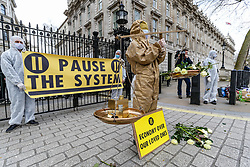 March 17, 2020, London, England, United Kingdom: Activists of 'Pause the System' group holding placards during a protest in front of number 10 Downing Street, the British Prime Ministers residence in London. The group is demanding the government to follow the World Health organisation's rules and get involved with enforcing isolation to prevent the spread of coronavirus across the country. (Credit Image: © Vedat Xhymshiti/ZUMA Wire)