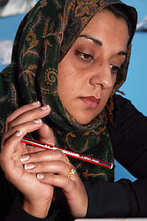 Woman thinking holding a pencil,