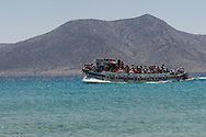 Greece, Koufonissi, Cyclades: Boat transporting a tourist